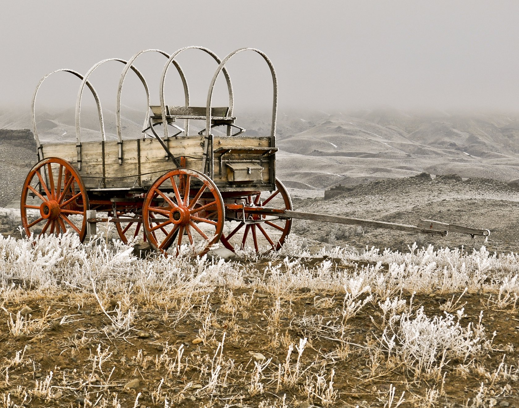 Old wagon on a frosty morning in Wapiti. WY  Ruth Faircloth.jpg